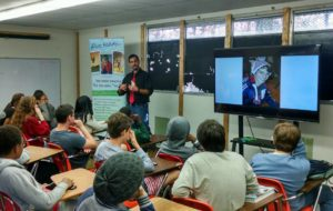 Demetrius Branca presents Anthony's story to a class full of students.
