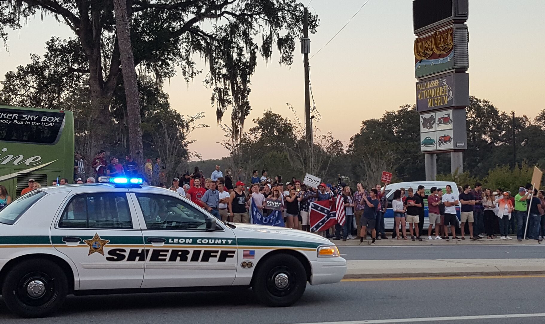 A crowd of trump supporters counter-protest the protesters across the street.